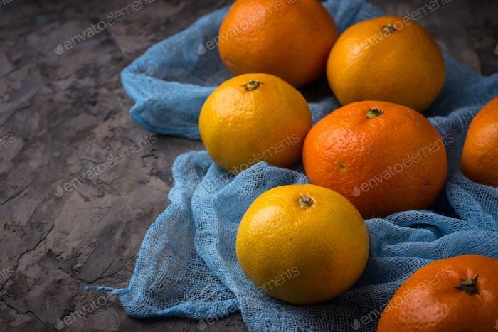 Sweet orange tangerines on concrete background