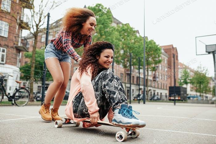 Young women enjoying skating outdoor