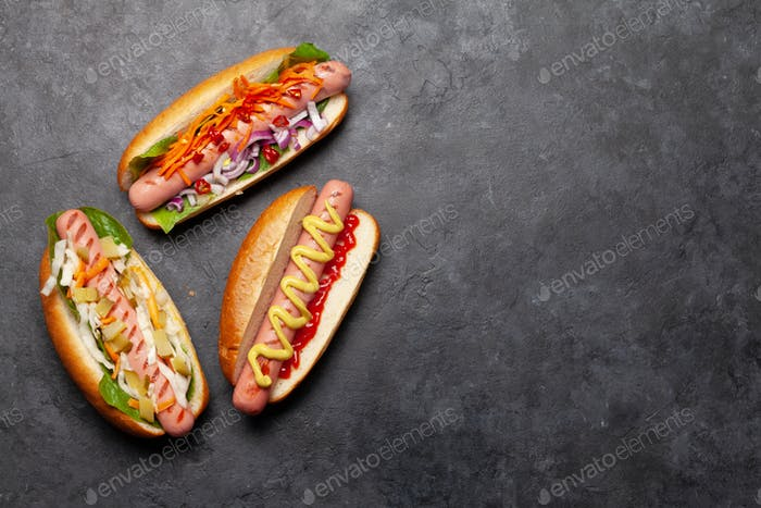 Various hot dog with vegetables, lettuce and condiments