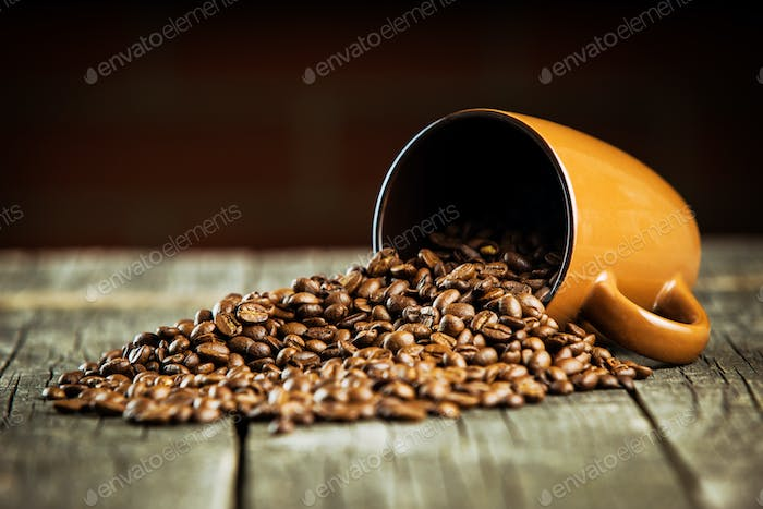 Coffee beans and coffee mug.