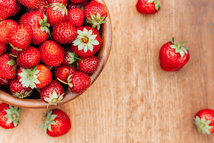 Bowl Filled With Fresh Ripe Red Strawberries On Wooden Table. To