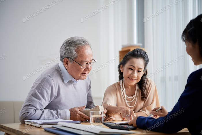 Senior Couple Buying Real Estate