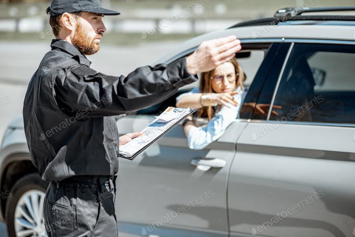 Policeman with female driver on the road