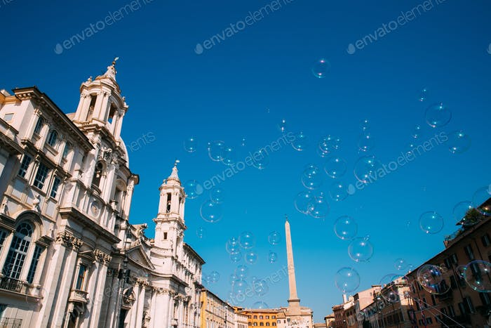 Rome, Italy. Soap Bubbles On Background Of Sant'agnese In Piazza