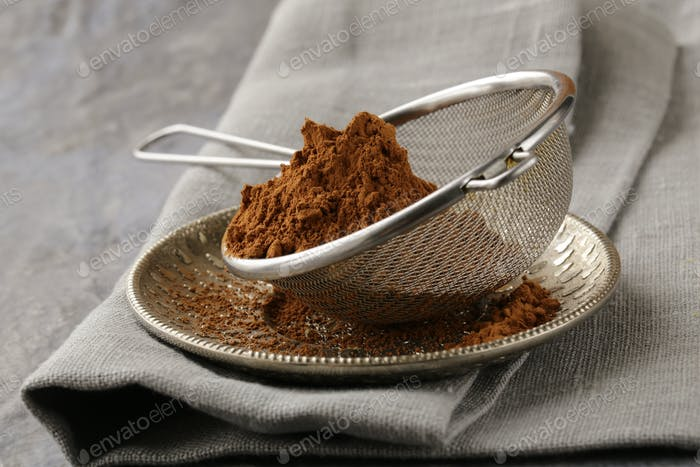 Cocoa Powder in a Metal Sieve