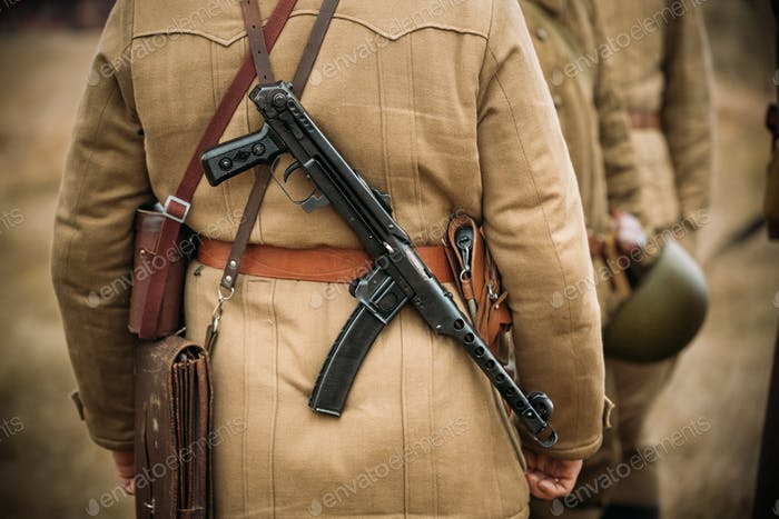 Re-enactor Dressed As Russian Soviet Infantry Soldier Of World War II With Sub-machine Gun Weapon