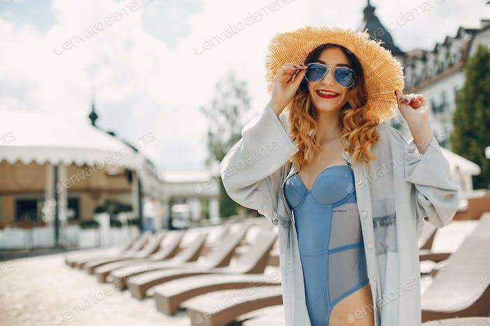 Beautiful and elegant girl on a resort