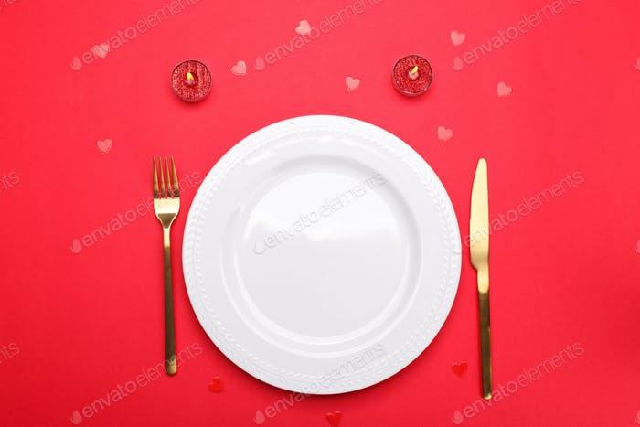 Romantic table setting with empty plate