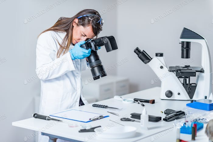 Forensic scientist examining murder weapon