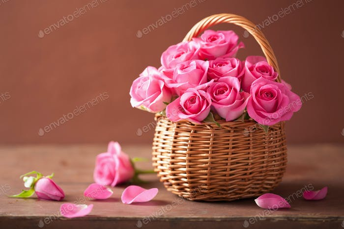 beautiful pink roses in basket