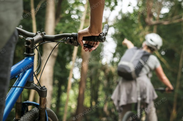 Group of diverse cyclist in the forest