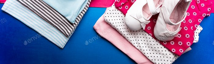 Banner of Folded blue and pink bodysuit with boat shoes on it on minimalistic