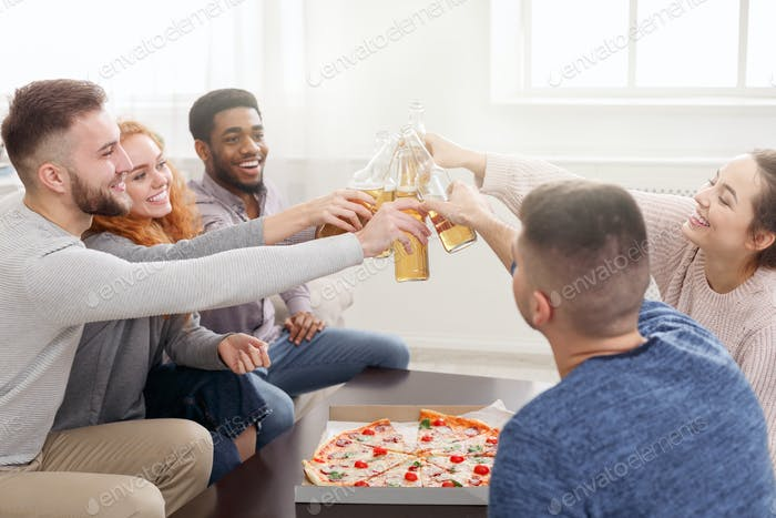 Young multiethnic friends celebrating meeting at home party