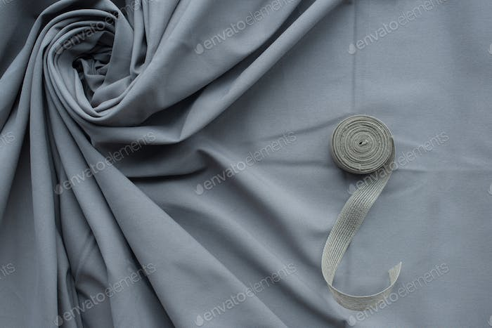 grey folds fabric with cloth roll background