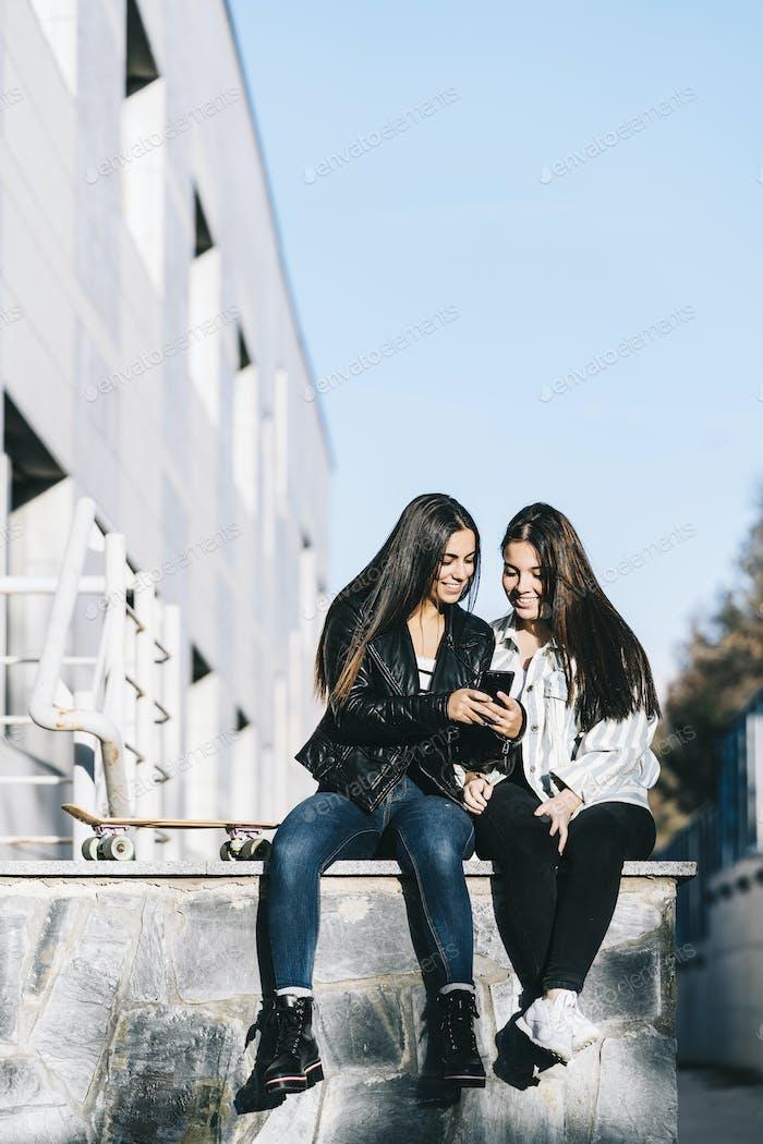 Girls using mobile phone