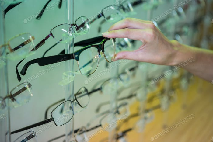 Woman shopping for new glasses at the optometry store
