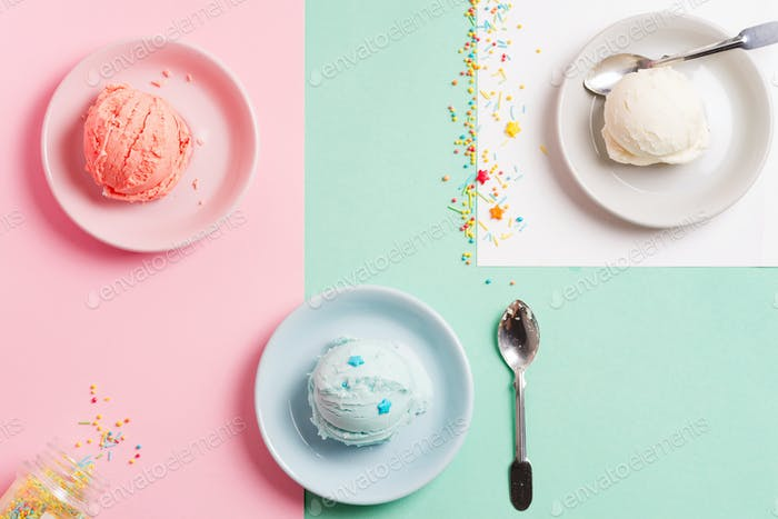 Three plates with fresh natural homemade fruits and vanilla ice-cream or gelato on a tricolor