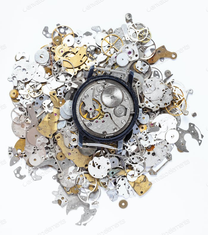top view of mechanic watch on heap of spare parts