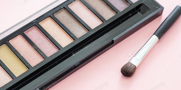 Eyeshadow pallete kit against pink background, copy space