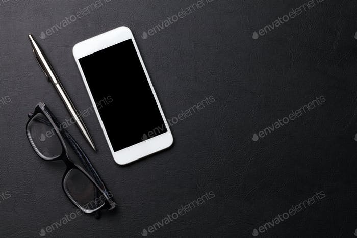 Smartphone on office workplace table