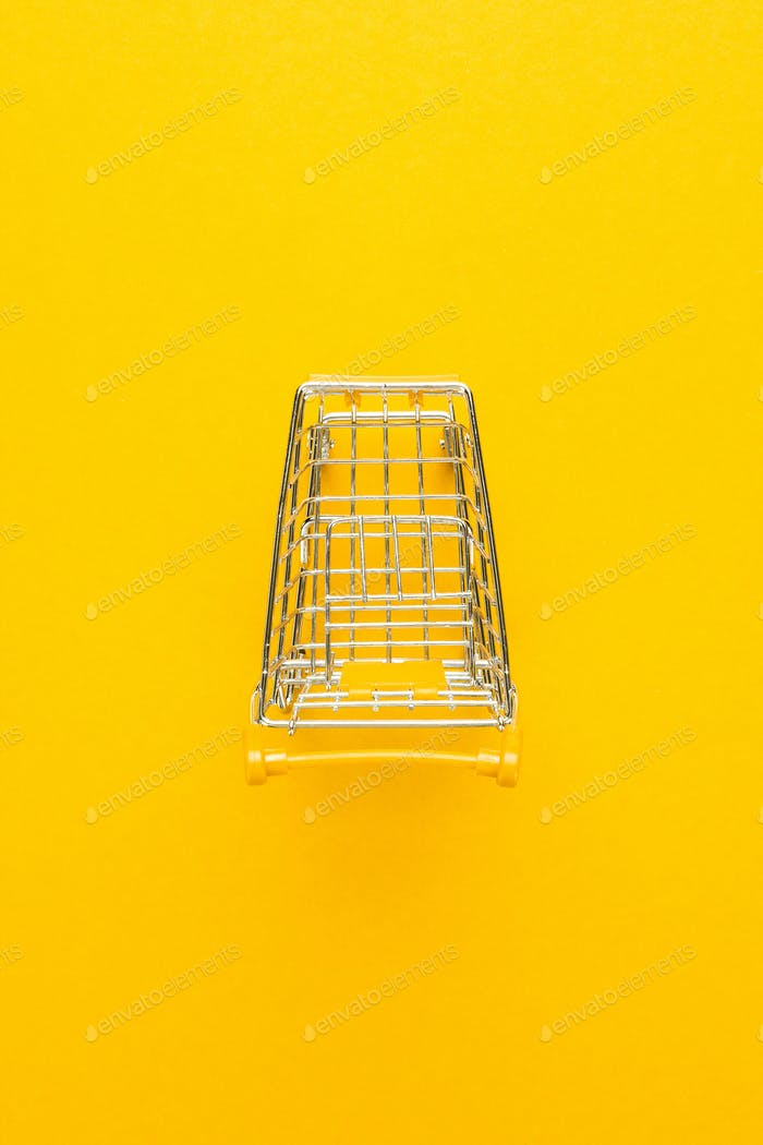 Top View Of Shopping Trolley On Yellow