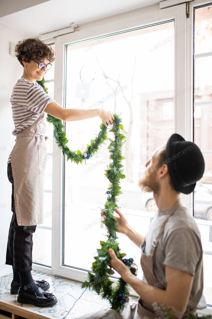 Hanging garland on window in cafe