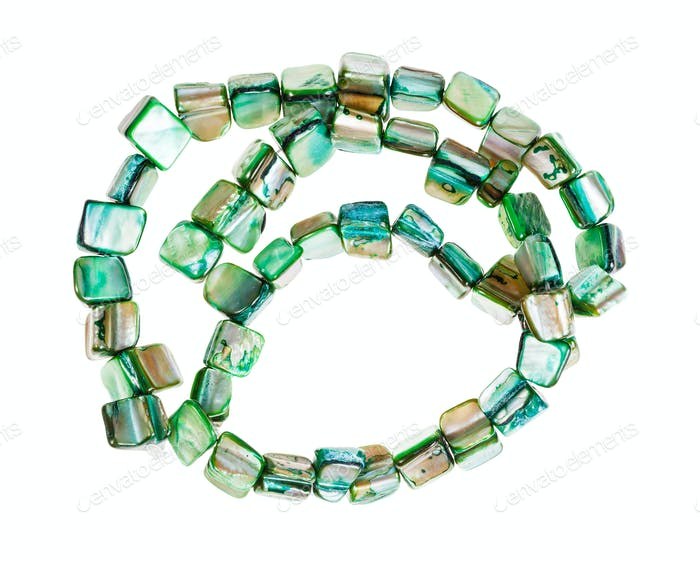 beads from green colored pieces of abalone shells