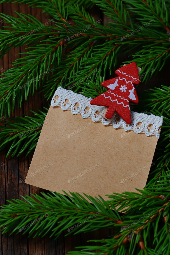Branch of Christmas tree and blank vintage paper