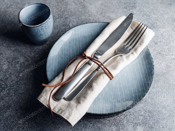 Served table setting with food blue ceramic set.