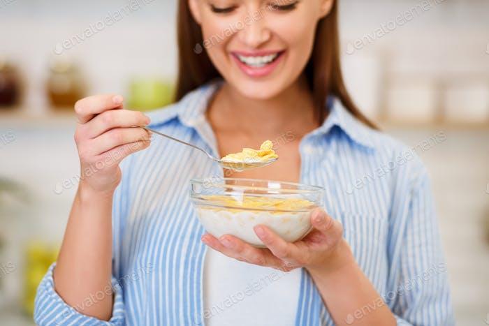 Healthy Breakfast. Girl Eating Cereals With Yogurt