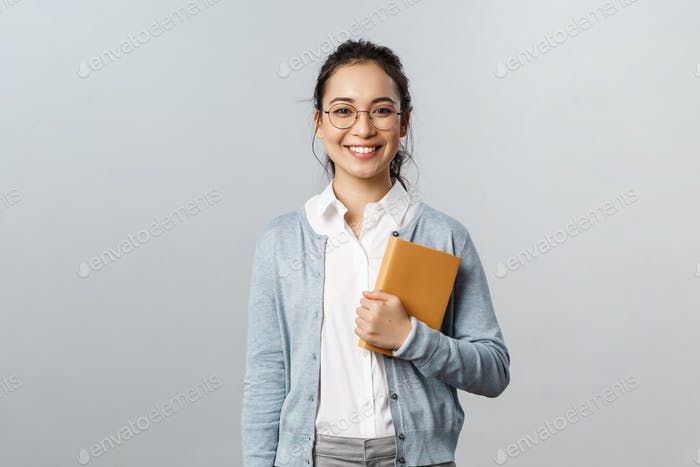Education, teachers, university and schools concept. Young smiling woman, employer or student in