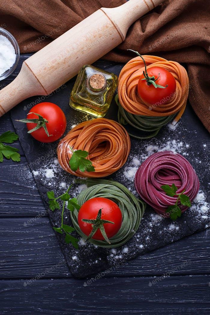 Uncooked color pasta tagliatelle