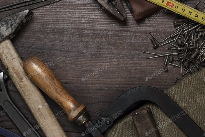 Construction Instruments On The Wooden Background