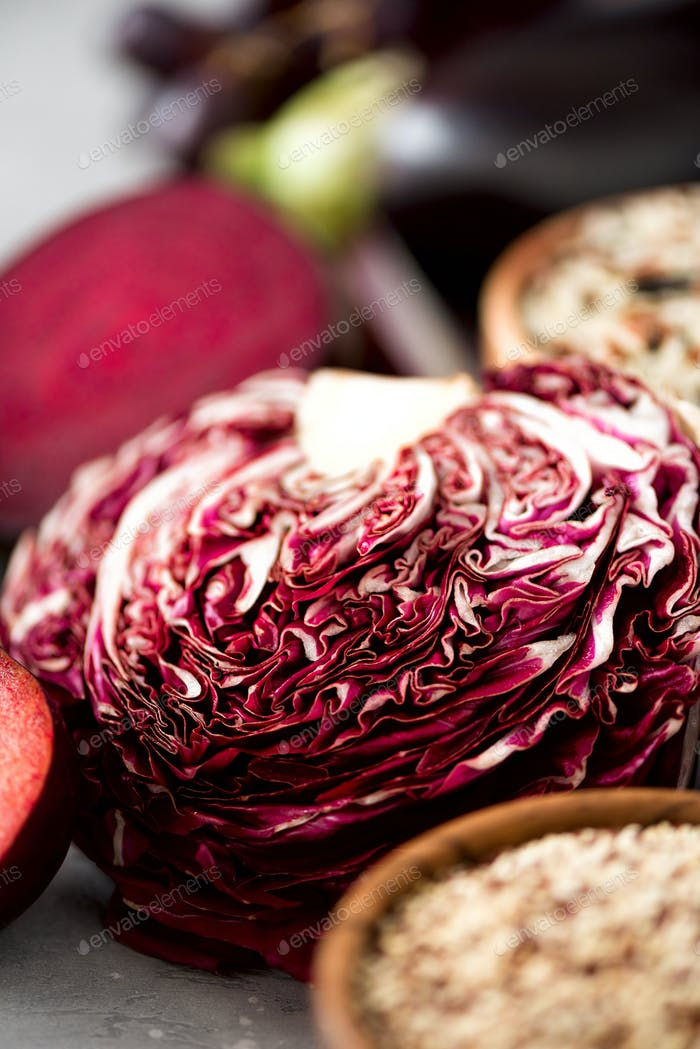Raw organic purple radicchio lettuce. Violet cabbage with ingredients for cooking. Clean eating