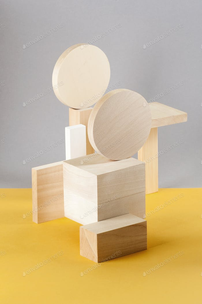 Abstraction from wooden geometric figures on a gray-yellow backg