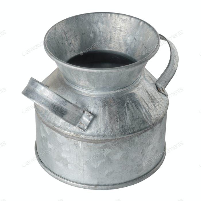 Empty rustic zinc-plated metal vessel