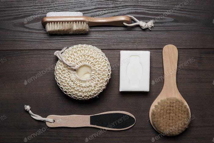 Bath Accessories On Brown Wooden Background