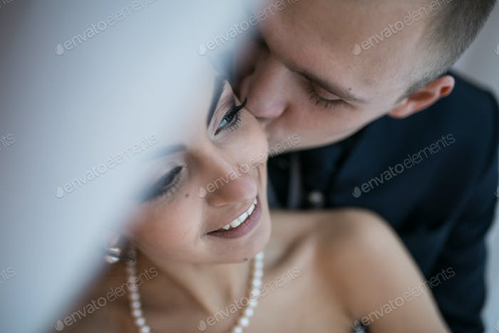 Beautiful European bridal couple in the hotel room