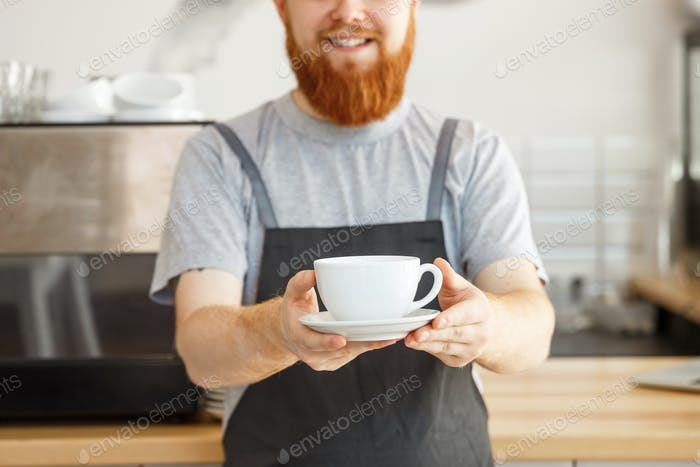 Coffee Business owner Concept - Portrait of happy young bearded caucasian barista in apron with