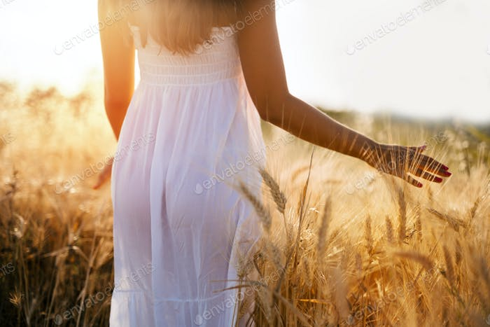 Beautiful woman in barley field