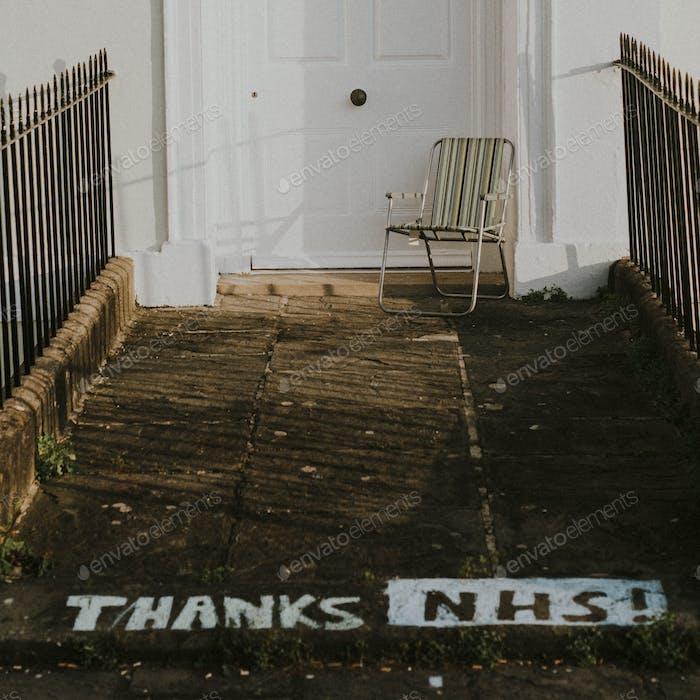 Thanks NHS! Graffiti by a sidewalk