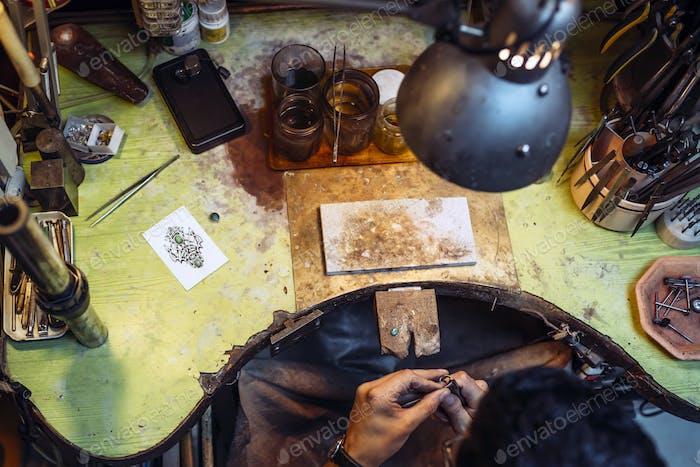 Craftsman working on workbench