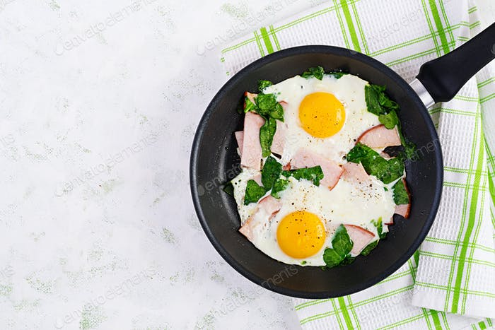 Fried eggs  with ham and spinach. Delicious English Breakfast. Brunch.