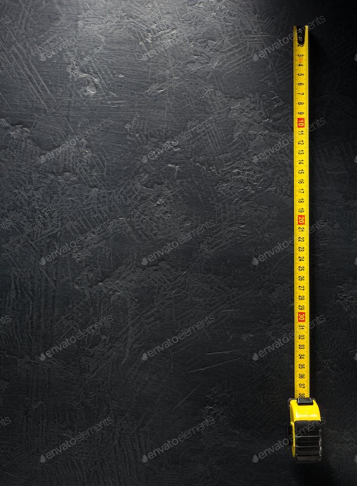 tape measure on black background
