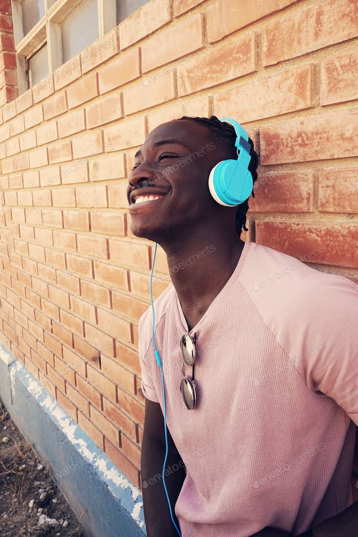 Young black man using a music headset