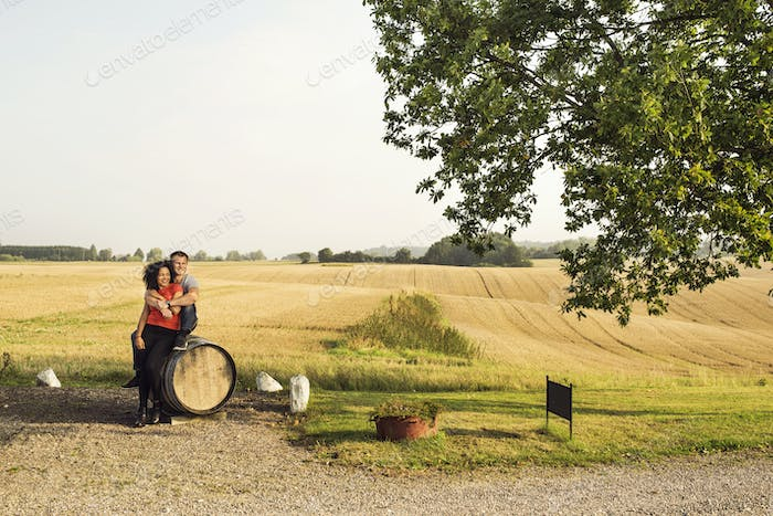 Rural scene with couple sitting on barrel