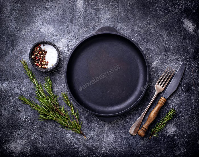 Cast iron frying pan with herbs and spices