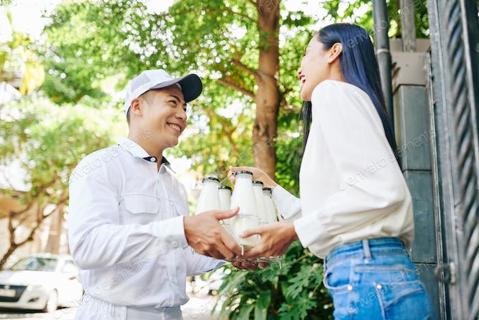 Delivering Milk To Young Woman