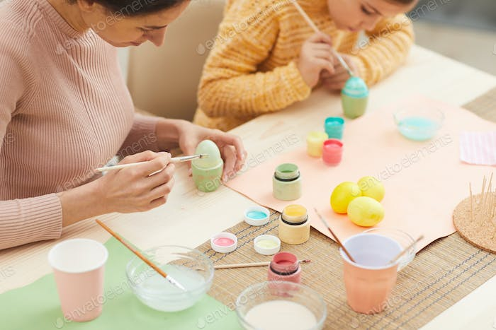 Family Hand Painting Easter Eggs