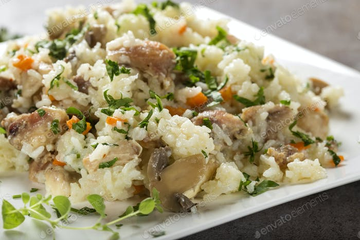 Rice with chicken meat and mushrooms